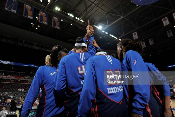 Alexis Hornbuckle and the rest of the Detroit Shock gather together to put their hands in before a game against the New York Liberty on August 29...