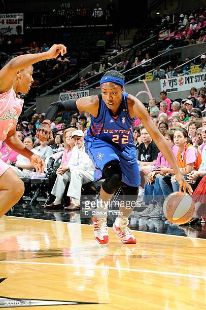 Alexis Hornbuckle of the Detroit Shock drives to the basket past Helen Darling of the San Antonio Silver Stars during the WNBA game on August 29 2009...
