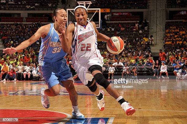 Alexis Hornbuckle of the Detroit Shock drives to the basket under pressure against KB Sharp of the Chicago Sky during the WNBA game on July 16 2008...