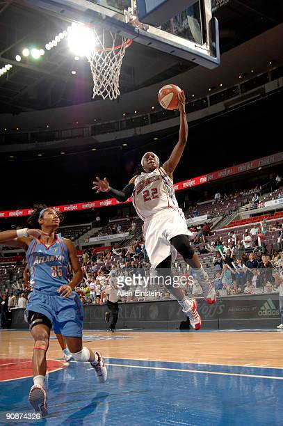 Alexis Hornbuckle of the Detroit Shock goes up for a layup over Angel McCoughtry of the Atlanta Dream in Game One of the WNBA Eastern Conference...
