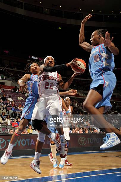 Alexis Hornbuckle of the Detroit Shock goes up for a shot attempt against Sancho Lyttle of the Atlanta Dream in Game One of the WNBA Eastern...