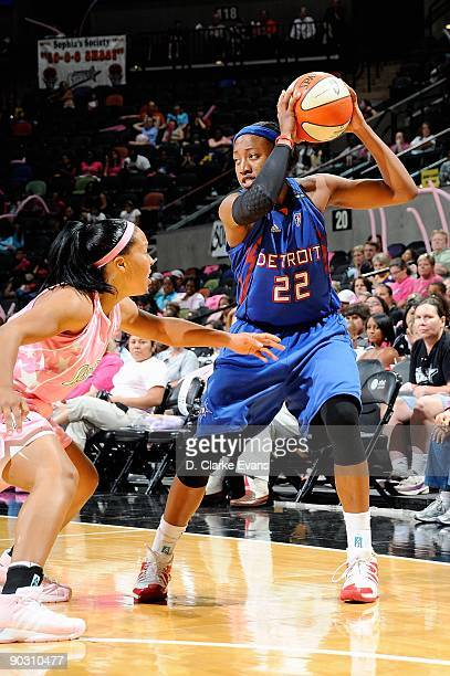 Alexis Hornbuckle of the Detroit Shock looks to pass over Helen Darling of the San Antonio Silver Stars during the WNBA game on August 29 2009 at the...