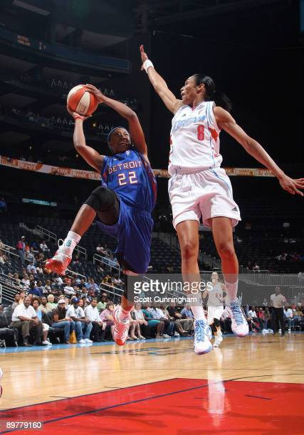 Alexis Hornbuckle of the Detroit Shock puts up a shot against Iziane Castro Marques of the Atlanta Dream at Philips Arena August 13 2009 in Atlanta...