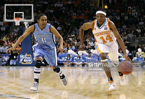 Alexis Hornbuckle of the Tennessee Lady Volunteers drives against Alex Miller of the North Carolina Tar Heels during their National Semifinal game of...
