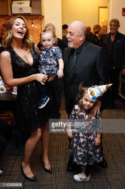 Alexis Joel and Billy Joel celebrate with their daughters Remy Anne Joel and Della Joel backstage on Joel's 70th Birthday and his 64th consecutive...