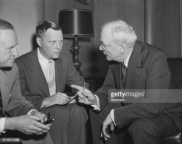 Alexis Johnson, U.S. Ambassador to Czechoslovakia, speaks with Secretary of State John Foster Dulles regarding the U.S. Role in talks with China at...