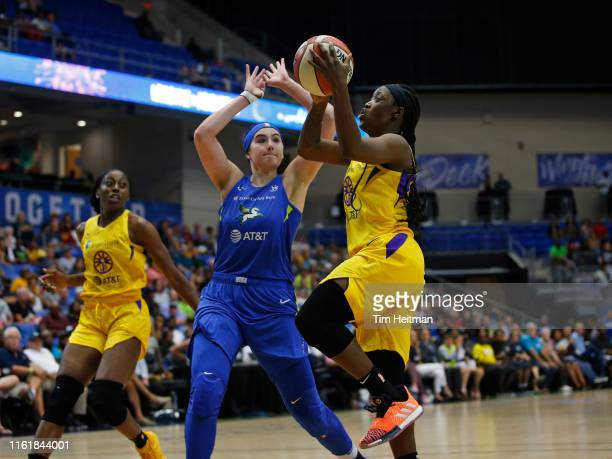 Alexis Jones of the Los Angeles Sparks goes to the basket against the Dallas Wings on August 14 2019 at the College Park Arena in Arlington Texas...