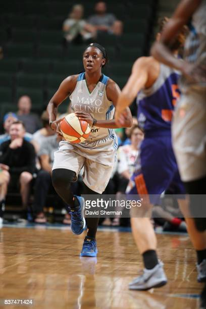 Alexis Jones of the Minnesota Lynx brings the ball up court against the Phoenix Mercury on August 22 2017 at Xcel Energy Center in St Paul Minnesota...