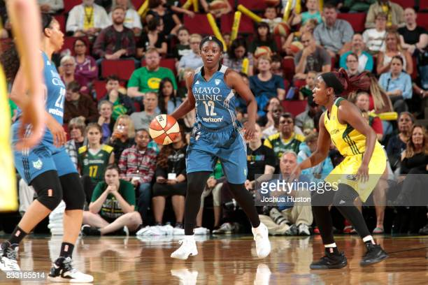 Alexis Jones of the Minnesota Lynx handles the ball against the Seattle Storm on August 16 2017 at Key Arena in Seattle Washington NOTE TO USER User...
