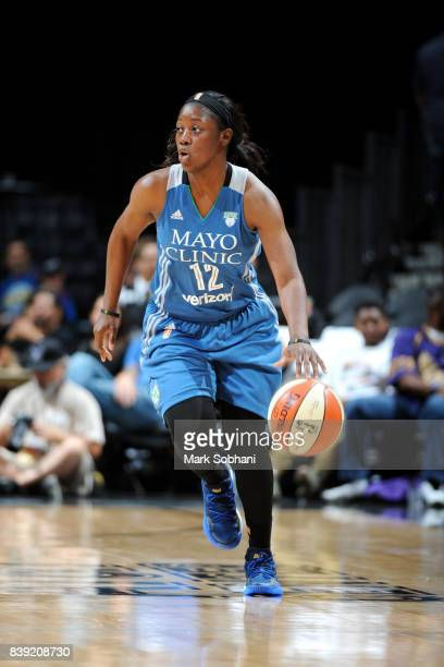 Alexis Jones of the Minnesota Lynx handles the ball during the game against the San Antonio Stars during a WNBA game on August 25 2017 at the ATT...