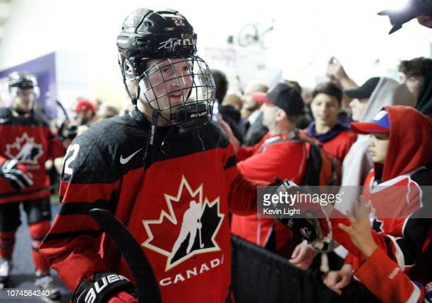 Alexis Lafreniere high fives with fans following a game versus Team Slovakia at the IIHF World Junior Championships at the SaveonFoods Memorial...