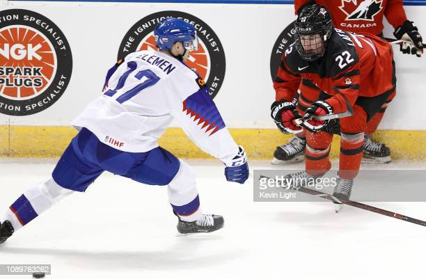 Alexis Lafreniere of Canada battles for the puck with Milos Kelemen of Slovakia at the IIHF World Junior Championships at the SaveonFoods Memorial...