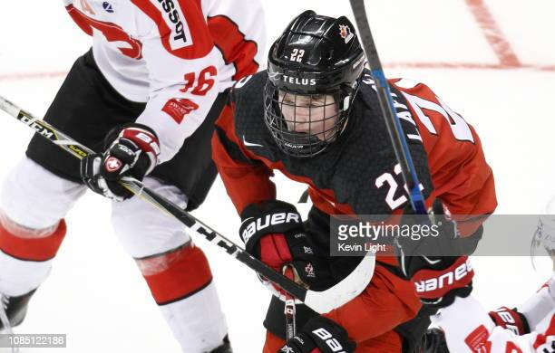 Alexis Lafreniere of Team Canada skates up ice versus Team Switzerland at the IIHF World Junior Championships at the SaveonFoods Memorial Centre on...