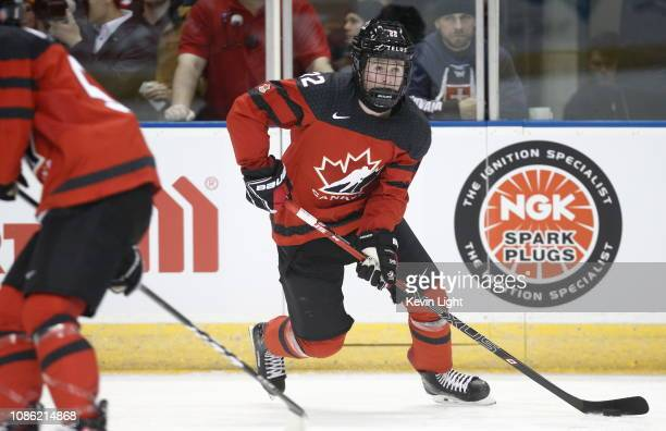 Alexis Lafreniere of Team Canada skates with the puck versus Team Slovakia at the IIHF World Junior Championships at the SaveonFoods Memorial Centre...