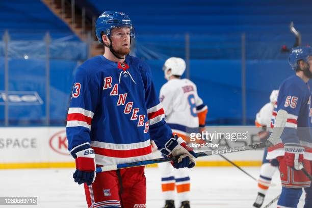 Alexis Lafreniere of the New York Rangers looks on during warmups before making his NHL debut against the New York Islanders at Madison Square Garden...