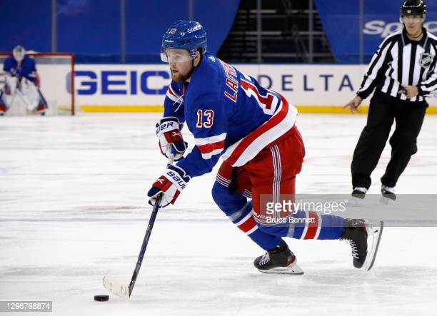 Alexis Lafreniere of the New York Rangers skates against the New York Islanders during the second period at Madison Square Garden on January 16, 2021...