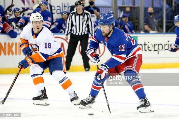 Alexis Lafreniere of the New York Rangers skates with the puck against the New York Islanders at Madison Square Garden on January 14, 2021 in New...