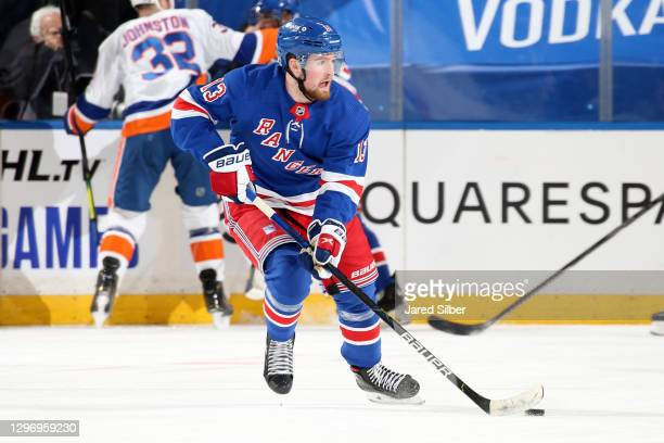Alexis Lafreniere of the New York Rangers skates with the puck against the New York Islanders at Madison Square Garden on January 16, 2021 in New...