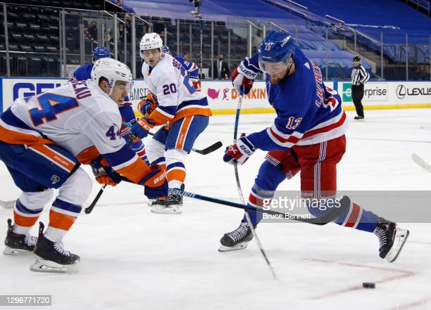 Alexis Lafreniere of the New York Rangers takes the first period shot against the New York Islanders at Madison Square Garden on January 16, 2021 in...