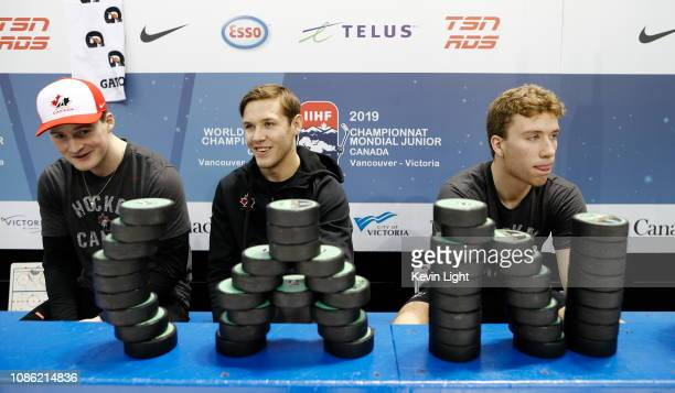 Alexis Lafreniere Ty Smith and Jared McIsaac of Team Canada sit on the bench prior to a game versus Team Slovakia at the IIHF World Junior...