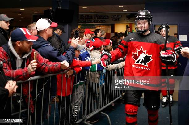 Alexis Lafrenière of Team Canada high fives with fans prior to a game versus Team Switzerland at the IIHF World Junior Championships at the...