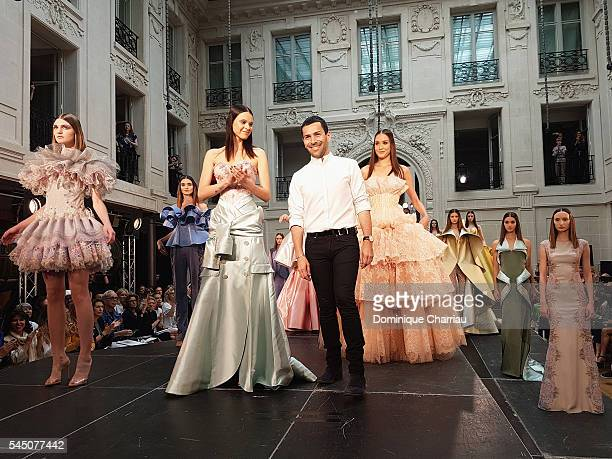 Alexis Mabille poses after the show during the Alexis Mabille Haute Couture Fall/Winter 20162017 show as part of Paris Fashion Week on July 5 2016 in...