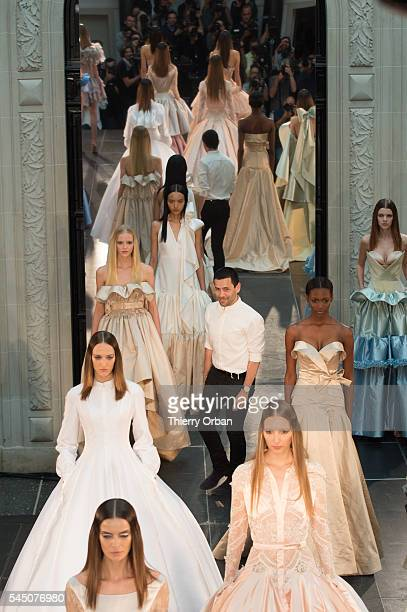 Alexis Mabille walks with models on the runway during the Alexis Mabille Haute Couture Fall/Winter 2016-2017 show as part of Paris Fashion Week on...