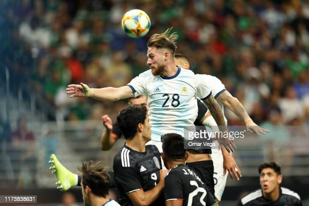 Alexis Mac Allister of Argentina heads the ball during the international friendly match between Argentina and Mexico at Alamodome on September 10...
