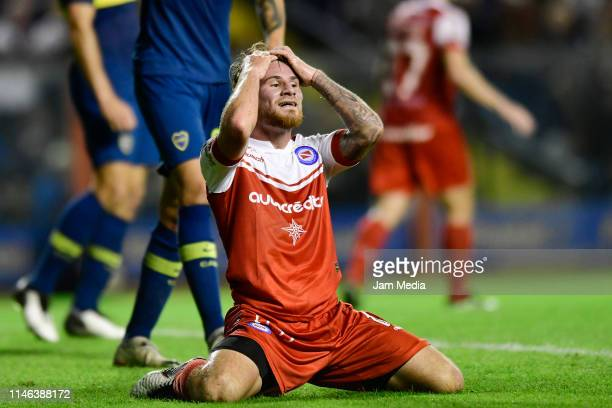 Alexis Mac Allister of Argentinos Juniors reacts after missing a goal during a during a second leg semifinal match between Boca Juniors and...
