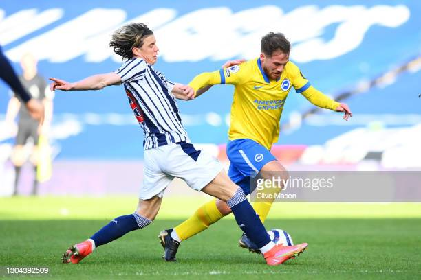 Alexis Mac Allister of Brighton and Hove Albion is challenged by Conor Gallagher of West Bromwich Albion during the Premier League match between West...