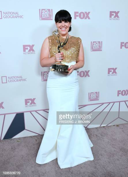 Alexis Martin Woodall poses with her award on arrival for the 'Fox FX National Geographic and Twentieth Century Fox TV Emmy Party' following the 70th...