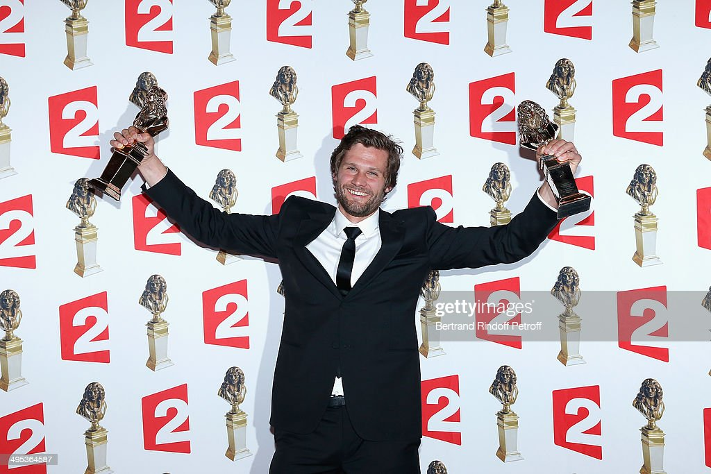 Alexis Michalik, winner of the Molieres of Francophone living Author and Moliere of Director of a private theater show for 'Le Porteur d'histoire' and Le Cercle des illusionnistes' pose with his two prices after the 26th Molieres Awards Ceremony at Folies Bergere on June 2, 2014 in Paris, France.