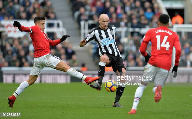 Alexis of Manchester United challenges Jonjo Shelvey of Newcastle United for the ball during the Premier League match between Newcastle United and...