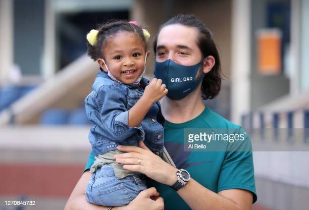 Alexis Ohanian and Alexis Olympia Ohanian Jr., husband and daughter of Serena Williams ,, attend the Women's Singles third round match between Serena...