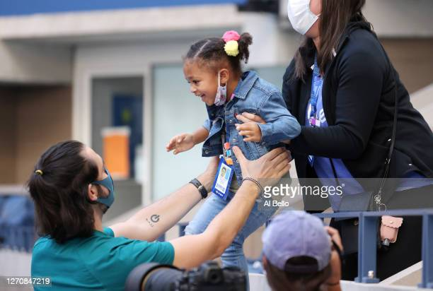 Alexis Ohanian and Alexis Olympia Ohanian Jr., husband and daughter of Serena Williams , attend the Women's Singles third round match between Serena...