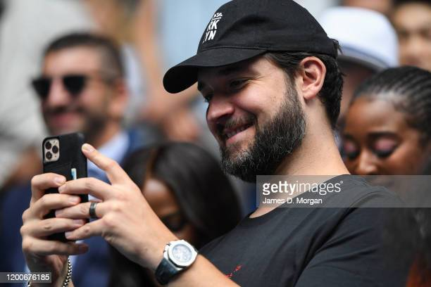 Alexis Ohanian, husband of Serena Williams filming her interview after winning her first round match against Anastasia Potapova of Russia on day one...