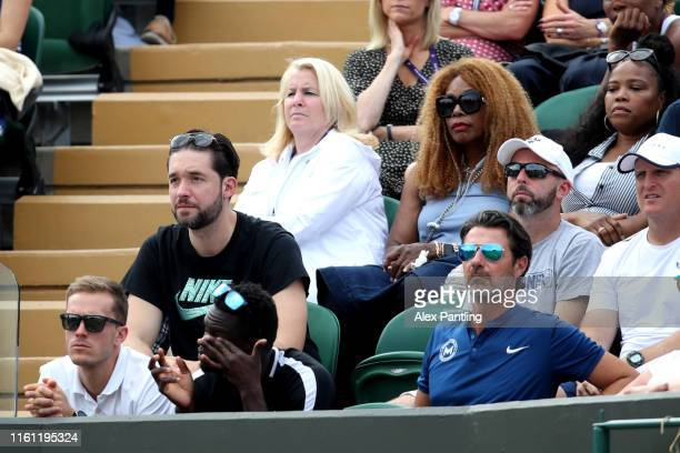 Alexis Ohanian, husband of Serena Williams looks on from the player box during the Mixed Doubles third round match between Serena Williams of the...