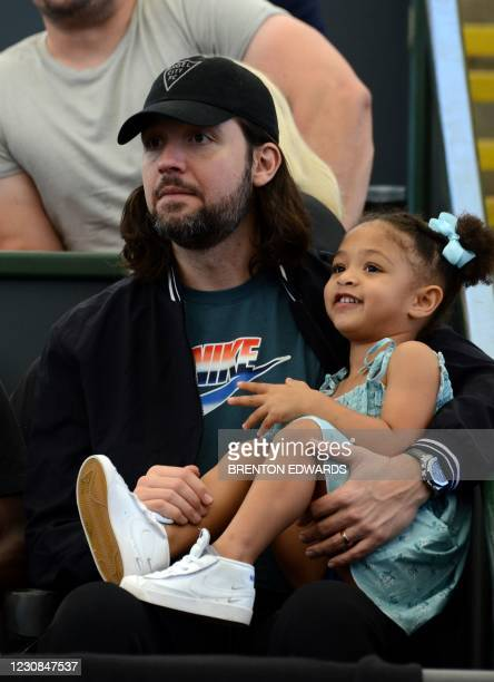 Alexis Ohanian, husband of Serena Williams of the US, watches her match against Naomi Osaka of Japan with their daughter Alexis Olympia Ohanian Jr...