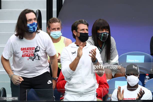 Alexis Ohanian, Patrick Mouratoglou, Jarmere Jenkins and Venus Williams watch the Women's Singles Quarterfinals match between Simona Halep of Romania...
