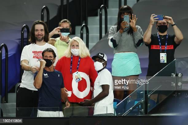 Alexis Ohanian, Patrick Mouratoglou, Jarmere Jenkins and Venus Williams watch the Women's Singles Quarterfinals match between Simona Halep of Romania...
