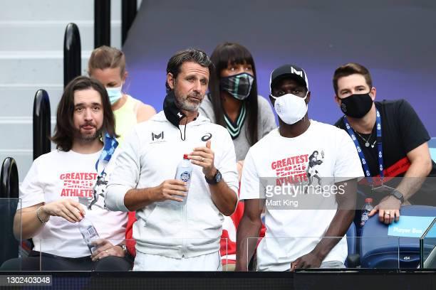 Alexis Ohanian, Patrick Mouratoglou, Jarmere Jenkins, Venus Williams and Derick Allen watch the Women's Singles Quarterfinals match between Simona...