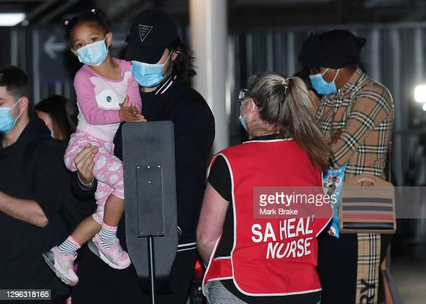 Alexis Olympia Ohanian Jr. Daughter of Serena Williams sterilizes her hands held by her father Alexis Ohanian arrives at Adelaide Airport on January...