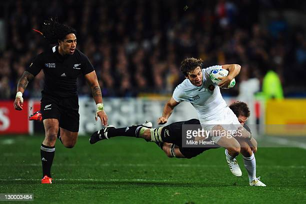 Alexis Palisson of France is tackled by Richie McCaw of the All Blacks during the 2011 IRB Rugby World Cup Final match between France and New Zealand...
