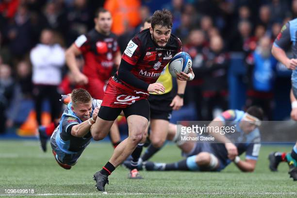 Alexis Palisson of Lyon bursts away from the challenge of Gareth Anscombe of Cardiff during the Champions Cup Pool 3 match between Cardiff Blues and...