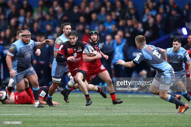 Alexis Palisson of Lyon makes a break as Gareth Anscombe of Cardiff closes in during the Champions Cup Pool 3 match between Cardiff Blues and Lyon...