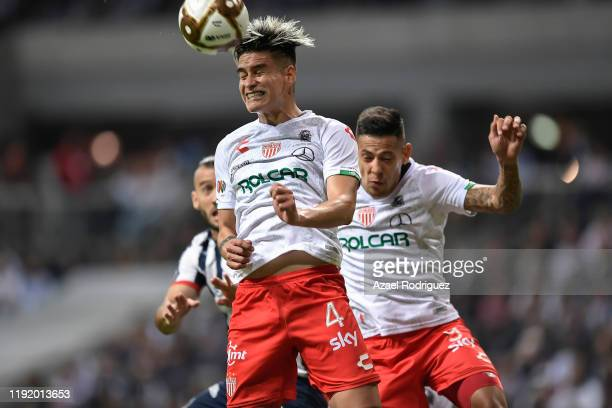 Alexis Peña #4 of Necaxa heads a corner during the Semifinals first leg match between Monterrey and Necaxa as part of the Torneo Apertura 2019 Liga...