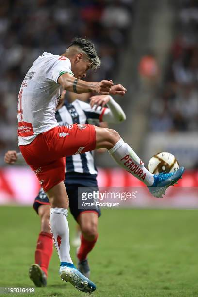 Alexis Peña #4 of Necaxa kicks the ball towards Vincent Janssen #9 of Monterrey during the Semifinals first leg match between Monterrey and Necaxa as...