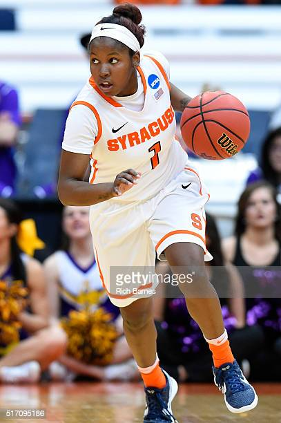 Alexis Peterson of the Syracuse Orange dribbles the ball up the court against the Albany Great Danes during the second half in the second round of...