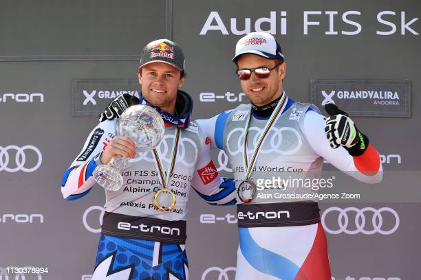 Alexis Pinturault of France takes 1st place in the overall standings Mauro Caviezel of Switzerland takes 3rd place in the overall standings during...