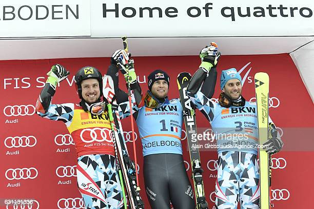 Alexis Pinturault of France takes 1st place Marcel Hirscher of Austria takes 2nd place Philipp Schoerghofer of Austria takes 3rd place during the...